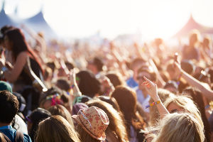 Photo of an audience at an outdoor music festival.