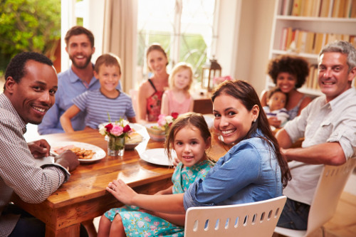 Photo of friends and family gathered at a dinner table.